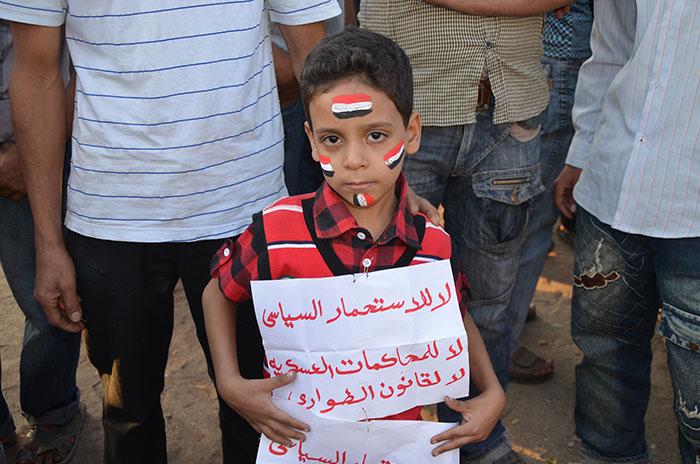 Junge bei Demonstration auf dem Tahrir Platz